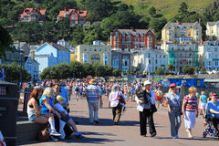 Seafront at Llandudno, Wales, UK. Many people walking along the seafront at Llandudno, North Wales, UK. This is a very busy old fashioned popular seaside resort Royalty Free Stock Image