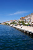 Seafront in Mali Losinj harbour,Croatia. Seafront view at Mali Losinj in a sunny summer day with blue sky and coloured houses Royalty Free Stock Photography