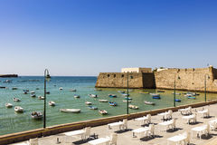 Seafront with old castle in Cadiz, Spain. Royalty Free Stock Photo