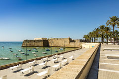Seafront with old castle in Cadiz, Spain. Stock Photography
