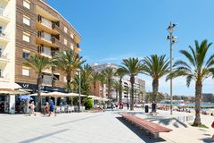Seafront palm lined promenade near popular Playa del Cura beach in Torrevieja, Spain stock photos