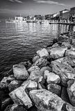 Seafront in Porec, Istria, Croatia, colorless. Seafront in Porec, Istria, Croatia. Summer vacation. Hotels and port with ships. Black and white photo stock photos