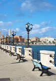 Bari. Seafront promenade with benches and old town in the background in Bari, Puglia, Italy Royalty Free Stock Photography