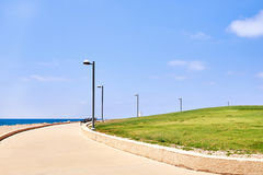Seafront promenade with grass Stock Images