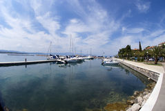 Seafront promenade and marina in Malinska on the island Krk in Croatia. Horizontal photo of seafront promenade and marina in Malinska on the island Krk with Royalty Free Stock Photography