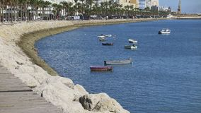 Seafront promenade and small boats in the port of cadiz Royalty Free Stock Images