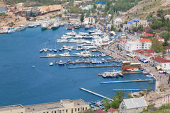 Seafront with ships at pier (Balaclava, Crimea) Royalty Free Stock Images