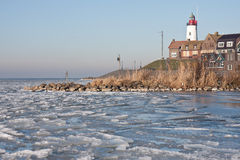 Seafront of Urk from frozen sea in the Netherlands Royalty Free Stock Image