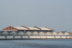 Seafront warehouses Royalty Free Stock Image