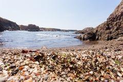 Seaglass on ocean shore Fort Bragg California CA Stock Image