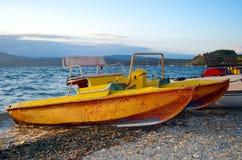 Seagoing catamaran. On the shore Stock Photography