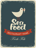 Seagull with a fish in its beak. Retro banner for a seafood restaurant menu with a seagull with a fish in its beak Royalty Free Stock Photography