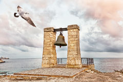 Seagull flies over  bell of Chersonesos Stock Images