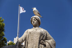 A seagull on the head of a statue in front of Princes Palace of. Monaco in Monte Carlo, Cote D'Azur Royalty Free Stock Photos