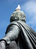 Seagull Perched on Head of Statue Stock Photo