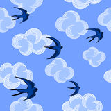 Seagulls and clouds seamless pattern on the blue sky background. Vector illustration. Stock Images