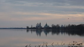 Seagulls fly over Nero's lake against Spaso-Yakovlevsky Monastery in Rostov stock footage