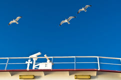 Seagulls in low flight over the ferry near Thassos island Royalty Free Stock Image