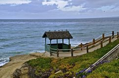 Seagulls Rest on Roof. Seagulls rest on a Roof of an Overlook Shelter as They View the Ocean Stock Images