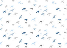 Seagulls silhouettes seamless pattern. Flock of flying birds   Royalty Free Stock Images