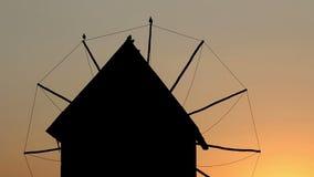 Seagulls stand on a windmill sunset Nessebar