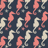 Seahorse Pattern. Illustration pattern of coral and gray seahorse silhouettes on a dark blue gray background Royalty Free Illustration