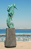 Seahorse statute on Malecón in Puerto Vallarta. A statute of a boy riding a seahorse stands on the Malecón in Puerto Vallarta, Mexico, in front of the Pacific Stock Photos