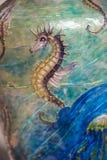 Seahorsemålning på en vas vektor illustrationer