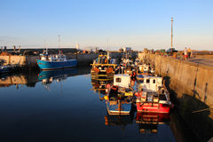 Seahouses Harbour. Fishing boats moored in Seahouses Harbour, Northumberland, UK Stock Image
