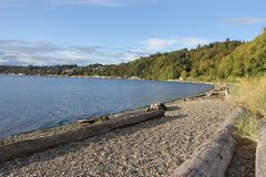 Seahurst Park Beach, With Pebbles. Pebble strewn beach in Seahurst Park. Landscape view of Puget Sound and south Seattle royalty free stock photo