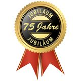 Gold jubilee seal. Seal colored black and gold with red ribbons for seventy-five years jubilee Stock Photo
