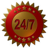 24-7 (seal). A 3D golden metallic seal with golden stars on a red ring and the text 24/7 in red Royalty Free Stock Photos