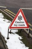 Señal de peligro helada de los caminos de la precaución Foto de archivo libre de regalías