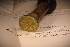 Seal. Old Signet with a coat of arms on an old written document stock images