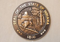 Seal of the State of Indiana. The Seal of the State of Indiana in bronze cast hangs on a wall. Indiana will be celebrating its bicentennial in 2016 stock images