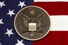 Seal of the United States shot on American flag royalty free stock image