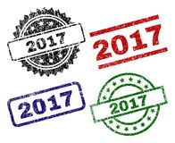 Grunge Textured 2017 Stamp Seals. 2017 seal watermarks with corroded texture. Black, green,red,blue vector rubber prints of 2017 title with unclean texture vector illustration
