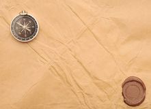 Seal wax and compass. On old paper background royalty free stock images