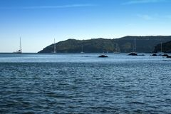 Sealandscape of Norsi on Elba Island, Italy. Wonderful panorama from Norsi beach. White boats on the background of the blue sky. This place is located on Elba stock images