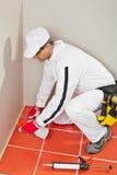sealant krzem rozpylający pracownik obraz stock