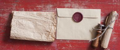 sealed brown envelope on wood background stock photography