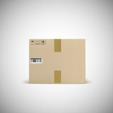Sealed cardboard box with barcode tape and traffic Stock Image