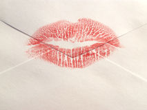 Sealed with a kiss. Lipstick kiss on an envelope stock photo