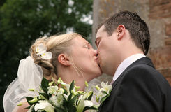 Sealed With A Kiss. Newly married couple Stock Photography