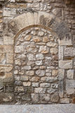 Sealed medieval arch. Ancient arch built of block stones, sealed, closed up with irregular natural stones. France, Provence Stock Photos