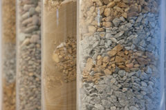 Sealed Rock Columns. Round glass columns of rock and sand royalty free stock photo