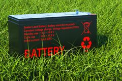 Sealed UPS battery on the green grass, 3d rendering. Sealed UPS battery on the green grass, 3d Stock Photos