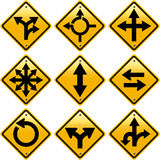 Señales de tráfico amarillas rombales con direcciones de las flechas Imagen de archivo libre de regalías