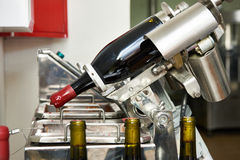 Sealing bottles of wine at winery Royalty Free Stock Photography