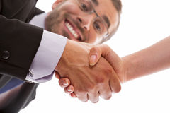 Sealing a deal. Happy and smiling businessman sealing a successful deal with a handshake Royalty Free Stock Images